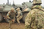 U.S. Army 1st Sgt. Jovanny Jones observes Ukrainian soldiers assigned to the 1st Battalion, 80th Airmobile Brigade.jpg