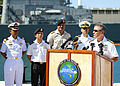 U.S. Navy Adm. Harry Harris, at lectern, the commander of U.S. Pacific Fleet, announces the beginning of Rim of the Pacific (RIMPAC) 2014 during a press conference at Joint Base Pearl Harbor-Hickam, Hawaii 140630-N-WF272-027.jpg