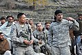 U.S. Navy Cmdr. Leonard Remias, front left, the commander of the Kunar Provincial Reconstruction Team, and an interpreter speak to Afghan residents during a shura, or meeting, in Lachey village, Shigal district 091207-A-AO884-318.jpg
