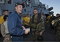 U.S. Navy Cmdr. Wilson Marks, left, the commanding officer of the guided missile destroyer USS Mason (DDG 87), welcomes French sailors assigned to the visit, board, search and seizure (VBSS) team aboard 140101-N-PW661-046.jpg