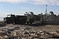 U.S. Navy Landing Craft Air Cushioned (LCAC) vehicle from Assault Craft Unit 5 unloads a U.S. Marine Medium Tactical Vehicle Replacement on Red Beach as part as Exercise Steel Knight aboard Camp Pendleton 131210-M-JF072-225.jpg
