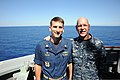 U.S. Navy Vice Adm. Scott H. Swift, right, the commander of the U.S. 7th Fleet, and Cmdr. Justin Orlich, the commanding officer of the guided missile destroyer USS Chung-Hoon (DDG 93), pose for a photo on 130529-N-GR655-021.jpg
