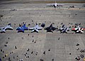 U.S. Service members and civilians walk along the flight line for a look at modern and vintage aircraft on display during the Centennial of Naval Aviation celebration at Naval Air Station Whidbey Island, Wash. 110730-N-ZK021-006.jpg