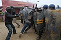 U.S. Soldiers assigned to the 2nd Squadron, 38th Cavalry Regiment and Albanian soldiers react to rioters, role played by U.S. Soldiers with the 1st Battalion, 4th Infantry Regiment, during the Kosovo Force 140118-A-EM978-042.jpg