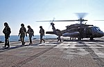 U.S. Soldiers with the 12th Combat Aviation Brigade walk from a UH-60 Black Hawk helicopter after landing aboard the amphibious command ship USS Mount Whitney (LCC 20) June 12, 2013, in the Baltic Sea during 130612-N-PE825-048.jpg