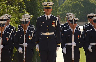 The United States Coast Guard Ceremonial Honor Guard wears variant dress blues with white gun belts at the Tomb of Unknown Soldiers. USCGCHG2006.jpg