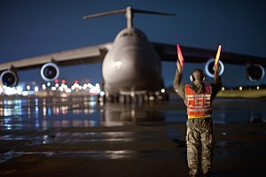 515th Air Mobility Operations Wing - A member of the wing marshalls a C-5 Galaxy at Yokota Air Base