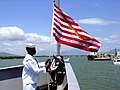 US Navy 020911-N-0000H-001 Raising the Navy Jack aboard ship.jpg
