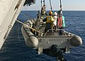 US Navy 021208-N-0275F-502 Sailors hold on to monkey lines as their rigid hull inflatable boat (RHIB) is hoisted from the water.jpg