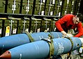 US Navy 030207-N-4048T-060 Aviation Ordnanceman secures bombs to a bomb rack in preparation for heavy seas.jpg
