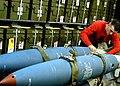 US Navy 030207-N-4048T-060 Aviation Ordnanceman secures bombs to a bomb rack in preparation for heavy seas.jpg