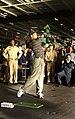 US Navy 040303-N-5319A-009 Sailors watch professional golfer Tiger Woods hit a few golf balls during a demonstration in the hanger bay of the nuclear powered aircraft carrier USS George Washington (CVN 73).jpg