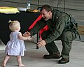 US Navy 040904-N-1113S-004 The Executive Officer for Sea Control Squadron Two One (VS-21), Cmdr. Paul Foster, reaches for a loved one upon his arriving home aboard U.S. Naval Air Facility Atsugi, Japan.jpg