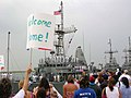 US Navy 050829-N-2006A-001 Friends and family members of Sailors aboard the mine warfare countermeasure ship USS Devastator (MCM 6), eagerly await the return the ship from a five-month deployment.jpg