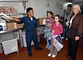 US Navy 060503-N-9860Y-127 Culinary Specialist 2nd Class Josue B. Milan, shows USS Blue Ridge (LCC 19) and 7th Fleet friends and family members around the shipUs bake shop.jpg