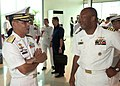 US Navy 060815-N-9851B-001 Commander, Destroyer Squadron One and the five-ship exercise Cooperation Afloat Readiness and Training (CARAT) Task Group, Capt. Al Collins talks with Commander Philippine Fleet, Rear Adm. George T Uy.jpg