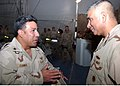 US Navy 061019-N-0606B-002 Master Chief Petty Officer of the Navy (MCPON) Joe R. Campa Jr. and Aviation Machinist's Mate 1st Class Javier Correa, of Expeditionary Logistics Unit (ELU) discuss the mission of Sailors servin.jpg