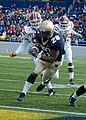 US Navy 061118-N-0696M-173 Naval Academy Midshipmen running back Reggie Campbell runs into the end zone for a touchdown versus the Temple University Owls at Navy-Marine Corps Memorial Stadium.jpg