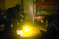 US Navy 070620-N-2294H-002 Explosive Ordnance Disposalman 1st Class Mica Greenwood and Explosive Ordnance Disposalman 2nd Class Joe Green illuminate a chemically contaminated area during a field exercise so a clean cover can be.jpg