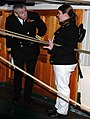 US Navy 071106-N-2893B-001 Seaman Katherine Wood gives a tour of the steerage area aboard USS Constitution to Lt. Cmdr. John Scivier, commanding officer of HMS Victory.jpg