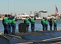 US Navy 080214-N-7668G-081 Los Angeles class attack submarine USS Augusta (SSN 710) render honors as the national Ensign is raised as the submarine arrives at Naval Station Norfolk.jpg