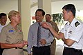 US Navy 080701-N-7095C-013 Rear Adm. Nora W. Tyson, left, commander of Logistics Group Western Pacific, Lim Yeon Khee, and Ng Chee Peng talk during a visit to MINDS for a community relations project.jpg