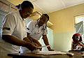 US Navy 080708-N-8977L-178 Lt. Cmdr. Lana Cole helps a local nurse perform triage.jpg
