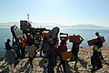 US Navy 080926-N-4515N-054 Haitian civilians unload relief supplies from a landing craft utility assigned to Assault Craft Unit (ACU) 2 embarked aboard the amphibious assault ship USS Kearsarge (LHD 3).jpg