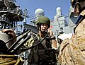 US Navy 090609-N-5345W-191 LT John Fairweather, a Visit, Board, Search and Seizure (VBSS) team leader assigned to Naval Beach Group 2, calls in a status update to leadership aboard USS Bataan (LHD 5).jpg
