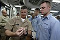 US Navy 090702-N-9818V-208 Master Chief Petty Officer of the Navy (MCPON) Rick West, left, gives Boatswain's Mate Seaman Brett Kish his Enlisted Surface Warfare Specialist pin during an awards ceremony aboard the USS John S. Mc.jpg
