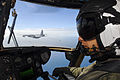 US Navy 090721-N-9950J-508 Marine Capt. Erick Min, assigned to Marine Medium Helicopter Squadron (HMM) 262, pilots a CH-53E Sea Stallion helicopter during an in-flight refueling.jpg