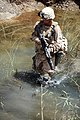 US Navy 090803-M-6237R-077 Navy Corpsman Seaman Apprentice Brandon Sills, assigned to Battalion Aid Station, 3rd Battalion, 11th Marine Regiment, crosses a canal during a patrol near Fire Base Fiddler's Green.jpg