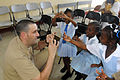US Navy 091120-N-7353K-041 Lt. Cmdr. Adam Goldberg, assigned to the amphibious command ship USS Wasp (LHD 1), plays with students at Fern Grove Basic Elementary School.jpg