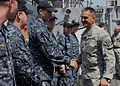 US Navy 100224-N-0808P-006 Maj. Gen. Daniel B. Allyn, deputy commander of Joint Task Force Haiti, greets Sailors aboard the amphibious dock landing ship USS Carter Hall (LSD 50).jpg