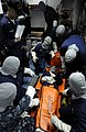 US Navy 100416-N-7280V-326 Hospital Corpsman 3rd Class Jayson Rollan conducts training with stretcher bearers.jpg