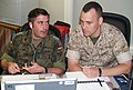US Navy 100618-N-1813L-002 German army Capt. David Gallagher, left, and U.S. Marine Corps Maj. William Barnes collaborate during the Coalition Warrior Interoperability Demonstration (CWID).jpg