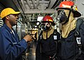 US Navy 100904-N-3705H-494 Navy Counselor 1st Class Carl Johnson trains Sailors on basic damage control during a damage control drill aboard USS Winston S. Churchill (DDG 81).jpg