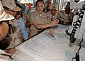 US Navy 101026-N-9156C-004 Lt. j.g. Vanessa Walton explains how she uses charts to visiting Royal Cambodian Navy officers during Cooperation Afloat.jpg