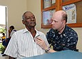 US Navy 110413-N-NY820-065 Lt. Cmdr. Karl Mitchell examines a Jamaican man on the first day of medical screening during Continuing Promise 2011 (CP.jpg