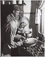 Unidentified man and boy preparing a meal, Drouin, Victoria (6173556739).jpg