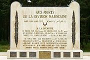"""White rectangular stone memorial. It is inscribed """"AUX MORTS DE LA DIVISION MAROCAINE"""", with other dedicatory messages in French, and with one phrase in Arabic."""