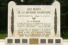 "White rectangular stone memorial. It is inscribed ""AUX MORTS DE LA DIVISION MAROCAINE"", with other dedicatory messages in French, and with one phrase in Arabic."