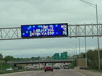 Variable-message sign - LED sign over Illinois State Route 390/Elgin-O'Hare Tollway in Roselle, Illinois showing remaining travel times.