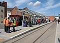 Waiting for a tram at Beeston Centre on opening day (geograph 4633122).jpg
