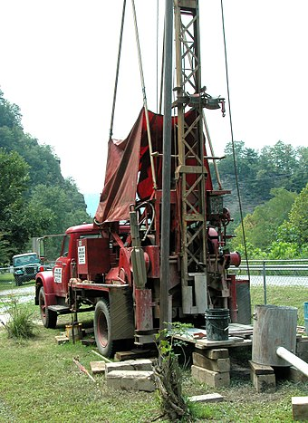 Cable tool water well drilling rig in West Virginia. These slow rigs have mostly been replaced by rotary drilling rigs in the U.S. Well spudder 8606.jpg