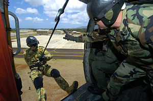 Wheeler Army Airfield - US Navy and Australian military members practice abseiling from a helicopter at Wheeler in 2006.