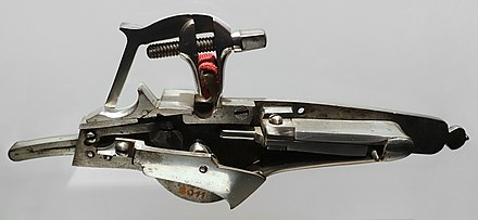 A wheellock pistol mechanism from the 17th century Wheellock for a firearm, 17th century, iron - Stadtmuseum Fembohaus - Nuremberg, Germany -DSC02125.jpg