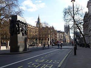 Whitehall - Whitehall pictured in 2012, with The Cenotaph and Monument to the Women of World War II in the middle of the carriageway, and the Elizabeth Tower housing Big Ben in the background.
