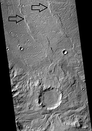 Wrinkle ridge - Floor and eroded south wall of the crater Flaugergues on Mars. Arrows point to wrinkle ridges.