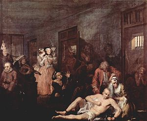 The Rake's Progress - Tom in Bedlam, comforted only by Sarah Young (Anne in the opera) – the last of Hogarth's paintings.